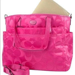 Coach diaper bag with hot pink changing pad